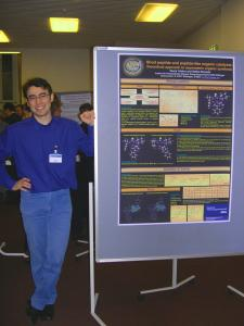 "Denis presents his poster at the SPP 1179 ""Organocatalysis"" Meeting in Mühlheim/Ruhr (Image: Tsogoeva)"